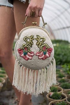 Brenda K.B. Anderson is constantly coming up with delightfully clever designs that showcase the versatility of crochet; the Flourishing Purse is no exception. Fun finishings like boho-esque tassels and floral embroidery motifs elevate this little bag.
