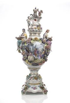 A Meissen style floral encrusted large covered urn on pedestal circa 1900