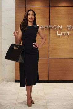 Gina Torres rocks a little black dress and handbag as Jessica Pearson on Suits