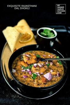 Exquisite Rajasthani Dal Dhokli Recipe - Whole Wheat Flour Dumplings Cooked With Seasoned Lentils is one of the most famous & traditional rajasthani dishes generally prepared and enjoyed in cold weather. Lentil Recipes, Veg Recipes, Curry Recipes, Indian Food Recipes, Vegetarian Recipes, Cooking Recipes, Ethnic Recipes, Vegetarian Dinners, Recipies