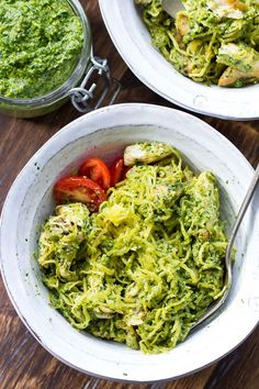 Perfectly cooked paleo spaghetti squash is tossed with a flavor-packed paleo & Whole30 pesto sauce and seasoned chicken. Whole30, dairy free and low carb.