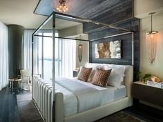 Majestic plum walls and a decadent ivory headboard give the master bedroom an opulent style with luxurious features.