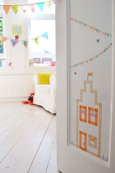 A No-Rules Nursery in the Netherlands Craft tape to create little house on the door?