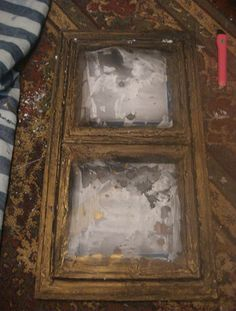Take dollar store frames and age them.  Aging picture frames