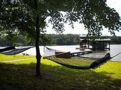 bask and relax on a lakeside hammock in the sun while enjoying the view of this breathtaking lake