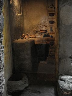 A small kitchen from Pompeii in the year 79, with cooking utensils.