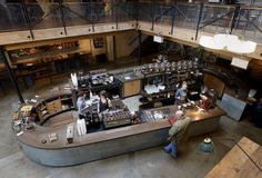 Sightglass Coffee in San Francisco. Coffee bar on the first floor and an upper floor of tables. #coffeeshop #design