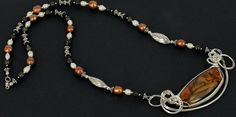 Royal sahara jasper sterling silver wire sculpted focal pendant on a long necklace of freshwater pearls, hematite and bali silver