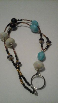 Check out this item in my Etsy shop https://www.etsy.com/listing/265325067/beaded-id-necklace-beaded-badge-holder