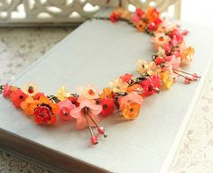 I'm overwhelmed by how beautiful this is!  Lucite Flower Necklace Flower Charm by apocketofposies on Etsy, $112.00