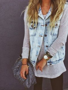 Light blue jean vest paired with stripes, black leggings, and gray handbag