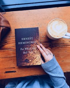 sweptaway-bybooks: Morning reading and coffee in the window of my new favourite coffee shop of all time. It's peaceful inside but bustling outside and I love the vibes ❤️ .