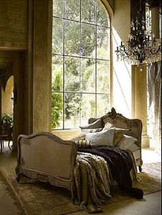 Love this bed. I like the coverings hanging at randome, and I especially like the bed in the middle of the room.