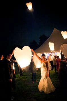 A backyard tented wedding with Chinese lanterns to end a wonderful night.