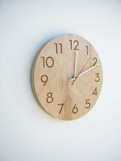 Would love a wall clock. This is an example of one I like but not fussy. modern wood wall clock by uncommon on Etsy, $65.00