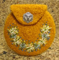 Ravelry: Agilejacks Yellow Felted Coin purse with blue embroidery