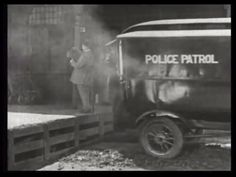 346. He doesn't see the police patrol car driving off. | Fast and Furious (1924)