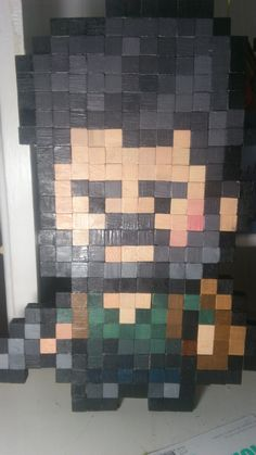 Joel from The Last of Us. Pixelated and made into wall art. ^^