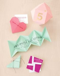 Easy Origami Paper Projects for Your Wedding: Leave a paper trail that guests won't forget, starting with your save-the-date. Revelers will easily spot their seats when geometric table numbers are perched among the place settings. At the ceremony, delight attendees with string-tied programs whose corners unfold to reveal all the need-to-know info. Come reception time, let partygoers unwrap giftlike escort cards.