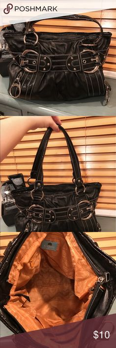 """Black Kathy Handbag This handbag features a large compartment perfect for your everyday bag. The black color makes it a perfect match for various outfits. This bag was owned by me and taken care of.  I can attest to its durability. It is in great condition. Measurements: L- 14"""" H - 10"""" Inside width - 10"""" and handles - 18 1/2"""".  This is a rock bottom price so price is firm. All pictures are mine unless otherwise stated. Check out product video on IG @melipcloset 🎥 Happy to answer any…"""