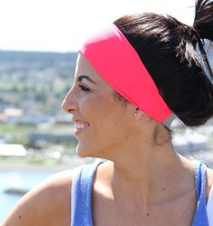 Neon Coral spandex headband by FitHappy! Only $15!  I bought one, and it doesn't slip while I'm working out!