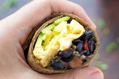 This Healthy Black Bean Breakfast Burrito Recipe features a bean-hash brown filling with eggs, cheese, avocado in whole wheat tortillas. Great to make ahead