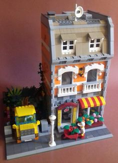 MAX ALDEGHERI built an orange modular flower shop. The three story building accommodates the flower shop on the first floor and living quarters on the upper levels.