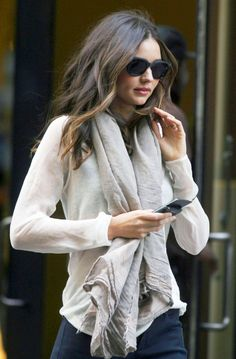 The scarf, glasses & loose waves in her hair make the look