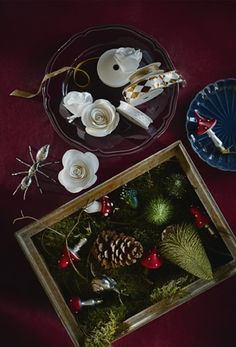 Tree decorations and ribbon in bowls and boxes on a table. Tree decorations and ribbon in bowls and boxes on a table. Ikea Christmas, Christmas Hacks, Christmas Traditions, Christmas Themes, Christmas Decorations, Plum Walls, Winter Holidays, Tree Decorations, Germany