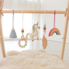 Baby play gym Rainbow Unicorn - Wooden gym frame and 5 toys: Unicorn, Rainbow, Mountain, Feather, beaded ring - Infant activity center Baby Play, Baby Toys, Wooden Feather, Feather Mobile, Play Gym, Frame Stand, Montessori Toys, Activity Centers, Rainbow Unicorn