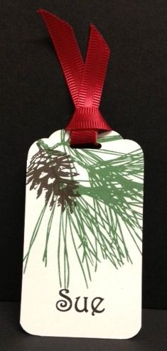 Handmade holiday/north woods/Christmas name tag using the ornamental Pine Stamp Set and Scalloped Tag Topper Punch from Stampin' Up!