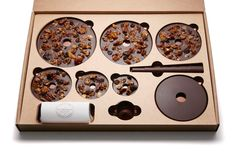 French chocolate company Alain Ducasse has released a dried fruit and nut-covered festive chocolate tree that comes in a flat-pack box Chocolate Christmas Gifts, Chocolate Tree, French Chocolate, Custom Chocolate, Chocolate Gifts, Alain Ducasse, Organic Cereal, Chocolate Festival, Tart