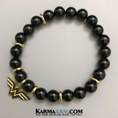 WONDER WOMAN | Black Onyx | Superhero #ComicCon CosPlay Attraction Bracelet ⭐ ⭐ ⭐  A logo of equality, energy, and fact, her herbal self belief and unmistakable intelligence made Marvel Lady unequaled. #WonderWoman #DCComics #Feminist #CosPlay #CharmBracelets #GiftsForHer #GirlPower #Feminism #SSDGM #MFM