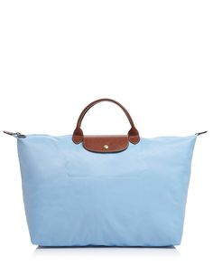 Longchamp Le Pliage Travel Bag - With a packable design and roomy interior, Longchamp's leather-trimmed travel bag is a jet-setter's necessity for work or play.