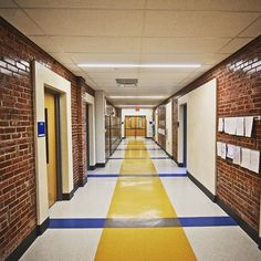 #corridor #interior #design #masonry #branding #colors #school #elementary.  Architects