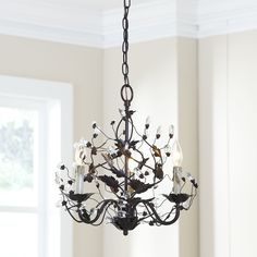 Palermo Chandelier | A showstopping addition to any grand room or entryway, the Palermo Chandelier brims with fine details and embellishments. Shaped iron creates trailing vines dotted with crystal buds, while the candle-style fixtures include faux dripped wax to enhance the feel of vintage elegance.