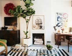 Another great example of a focal point that is NOT a television. I don't have a fireplace, but I could find a tall beautiful antique bookcase or dresser instead, and place a painting and/or other accessories on top, and maybe a tall plant next to it, to make it a focal point for the room.