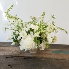 All white summer wedding flower centerpiece with white peonies, white foxglove and white roses by Foraged Floral in Portland, OR