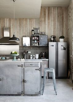 "metal clad cabinetry, Moroccan tile backsplash, vertical gray weathered wood, modern vent hood, ""found"" mismatched upper cabinets, stainless steal appliances.  A good mix of styles.  Making something lovely with what you've got already.  Lots of character and still practical."