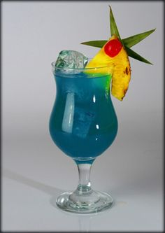 Blue Hawaiian Blue Hawaiian Drink, Cocktail Drinks, Cocktails, Blue Curacao, Hurricane Glass, Diy Home Decor, Recipies, Food And Drink, Tableware
