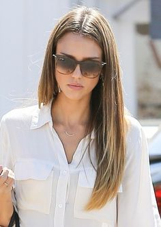 Jessica Alba. Love the hair and glasses! Does anyone know the brand?