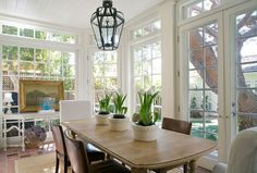 I love this dining room surrounded by windows. This would also make a great sunroom as well.