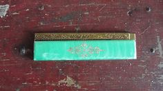 Flip-Comb-gold-plated-green-celluloid-vintage