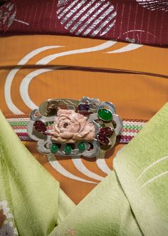 set A. Maiko and geisha obidomes. [ Obidome are small brooches worn threaded onto the obijime, making a charming decoration on the front of the obi.] 2012, Kyoto, Japan. Photography by Stephane Barbery