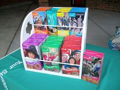 Display for cookie boxes at a booth.