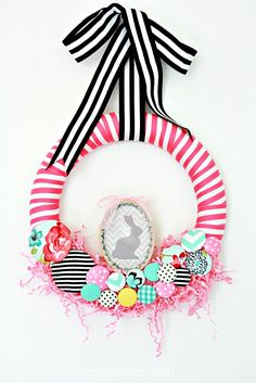 A beautiful and eclectic Easter parade Wreath full of fabric, covered buttons, and dollar store finds. A tutorial on how to make a wreath for Spring