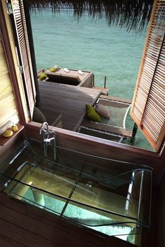 clear bathtub over the ocean