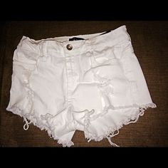 Buckle shorts white shorts • holey • fits a 24 • worn two or three times Klique B Shorts Jean Shorts
