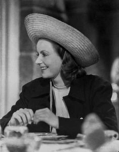 Greta Garbo with a Hat and smiling Premium Art Print