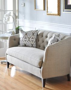 tufted sofa instead of two chairs in the living room or family room~~~sort of a change of pace.